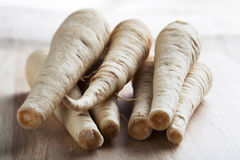 Parsnips on Cutting Board Stock Images