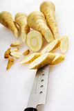 Parsnips and knife Stock Image