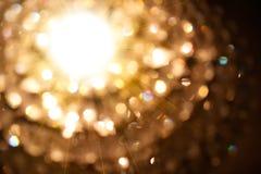Partícula de oro de luces Imagen de archivo libre de regalías