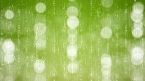 Partículas abstractas Bokeh en fondo verde almacen de metraje de vídeo