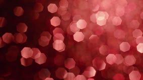 Partículas brillantes abstractas del brillo Fondo abstracto con las chispas brillantes rojas del bokeh Luz del reflejo almacen de metraje de vídeo