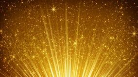 Partículas de levantamiento del oro en rayos ligeros Imágenes de archivo libres de regalías