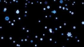 Partículas de los copos de nieve caidas abajo en la pantalla negra metrajes