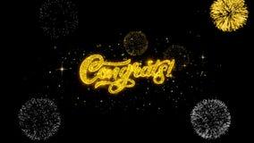 Partículas de oro del centelleo del texto de Congrats con la exhibición de oro de los fuegos artificiales