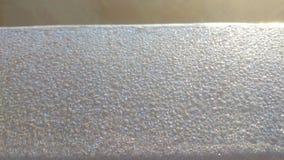 Partículas del hielo congeladas a un carril Foto de archivo libre de regalías