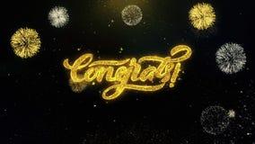 Partículas escritas Congrats del oro que estallan la exhibición de los fuegos artificiales