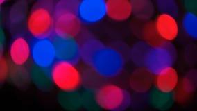 Partículas móviles Colorido, empañado, el bokeh enciende el fondo metrajes