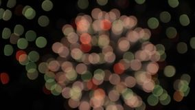 Partículas moventes bonitas e brilho do fundo colorido dos fogos-de-artifício do bokeh do sumário da explosão filme
