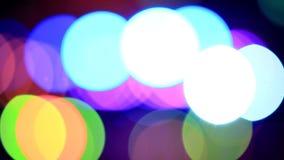 Partículas moventes Colorido, borrado, o bokeh ilumina o fundo Sparkles do sumário filme