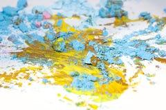 Partículas y pintura en colores pastel quebradas Imagen de archivo
