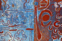 Part of an abstract native Aboriginal painting, Australia. Part of an abstract and ancient native Aborigine painting, made with a dotting technique in red,blue Royalty Free Stock Images