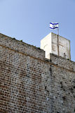 Fort & Israel Flag. Part of the Acco fort located at the old town of Acco (Acre), Israel. The forthad been built in the days of the Ottoman empire, on the ruins Royalty Free Stock Images