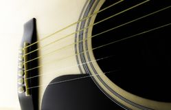 Part of an acoustic guitar. Closeup on a white background Stock Images