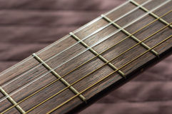Part of an acoustic guitar with strings Royalty Free Stock Photos
