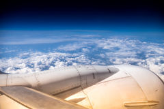 Part of aircraft above the clouds Stock Photos