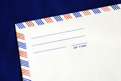 Part of the airmail envelope. Isolated on blue Royalty Free Stock Images