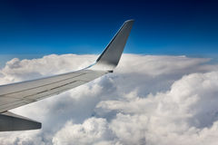 Part of airplane wing on sky background Stock Image