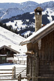 Part of an alpine hut in winter Royalty Free Stock Photos