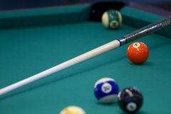Part of the American pool table with balls and cue. Closeup Royalty Free Stock Images