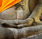 A part of ancient Buddha statue in meditation position Stock Photography