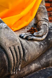 A part of ancient Buddha statue in meditation position Royalty Free Stock Image