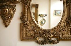 A part of an antique mirror. Frame in gold color Stock Photos