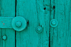 The Part of Aquamarine Old Vintage Door with Crack Paint and Big Steel Bolt with Screw and Nuts,Texture,Background. The Part of Aquamarine Old Vintage Door with Stock Images