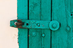 The Part of Aquamarine Old Vintage Door with Crack Paint and Big Steel Bolt on the White Wool,Texture,Background Royalty Free Stock Image