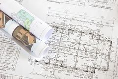 Part of architectural project. Architectural blueprints and blueprints rolls closeup stock photo