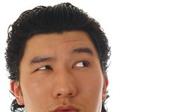 Part of asian man face Stock Photos