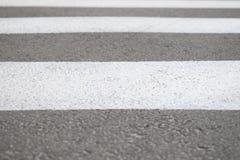 Part of asphalt road with crosswalk. stock images