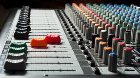 Part of an audio sound mixer. With buttons and sliders royalty free stock image