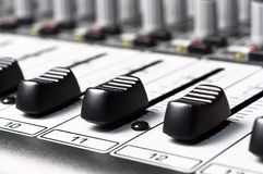 Part of an audio sound mixer. With buttons royalty free stock photography