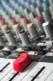 Part of an audio sound mixer. With buttons and a slider stock image