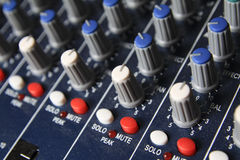 Part of an audio sound mixer with buttons. Buttons equipment in audio recording studio of the green colour Stock Photography