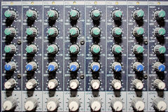 Part of an audio sound mixer with buttons and sliders Stock Photos
