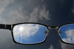 Part of bad sky and glasses with blue sky Royalty Free Stock Photo