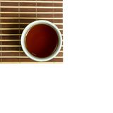 A part of bamboo mat with the Japanese teacup Stock Photos