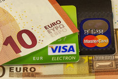 Part of bank cards Visa and Master Card and parts of the euro ba Royalty Free Stock Photo
