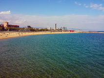 Part of Barcelona's Skyline seen from the beach with sea in the Royalty Free Stock Photos