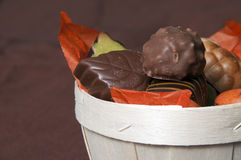 Part of Basket of chocolate on brown background Royalty Free Stock Image