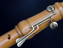 Part of bass recorder against dark background. Part of bass recorder against dark black and blue background stock image