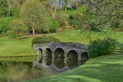 English country house garden at Stourhead. Part of  the beautiful English country house garden of Stourhead in Wiltshire with water and trees. `A living work of Stock Photo