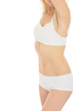 Part of beautiful fit slim woman body in white. Underwear. isolated stock photography
