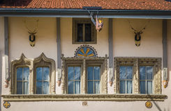 Part of beautiful houses. Beautiful windows on old houses in Gruyere village, Switzerland, architecture detail Stock Photos