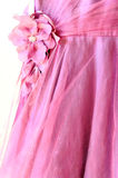 Part of beautiful pink dress with decorative flower Stock Image