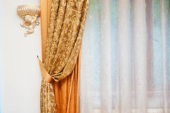 Part of beautifully draped curtain and wall with patterns Royalty Free Stock Images
