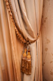 Part of beautifully draped curtain and wall with patterns Stock Photos