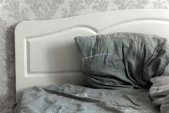Part of the bed. With headboard and pillow Stock Photography