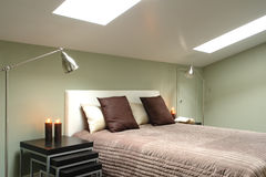 A part of bedroom. Bright bedroom in the attic Stock Photos